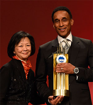 Mannie Jackson standing with Chancellor Phyllis Wise, holding the NCAA Theodore Roosevelt Award